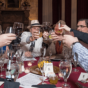 Minneapolis Murder Mystery guests raise glasses