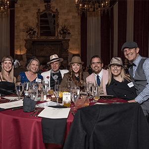Minneapolis Murder Mystery party guests at the table